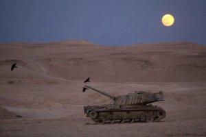 Full supermoon rising over the Judean Desert