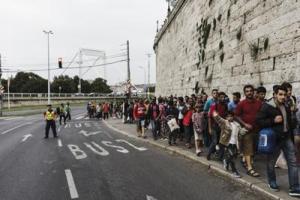 migranti_infophoto