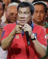 Philippine presidential race front-runner Davao city mayor Rodrigo Duterte gestures to the crowd during his final campaign rally in Manila, Philippines on Saturday, May 7, 2016. A bruising presidential campaign drew to a close in the Philippines Saturday with a last-minute attempt by the president to unify candidates against a front running mayor perceived as a threat to democracy virtually collapsing. (ANSA/AP Photo/Aaron Favila) [CopyrightNotice: Copyright 2016 The Associated Press. All rights reserved. This material may not be published, broadcast, rewritten or redistribu]