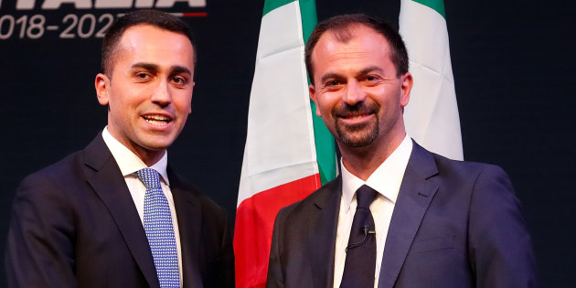 5-Star Movement leader Luigi Di Maio shakes hands with Lorenzo Fioramonti, who would be Ministry for Economic Development in any 5-Star government, during the presentation of the would-be cabinet team, ahead of election in Rome